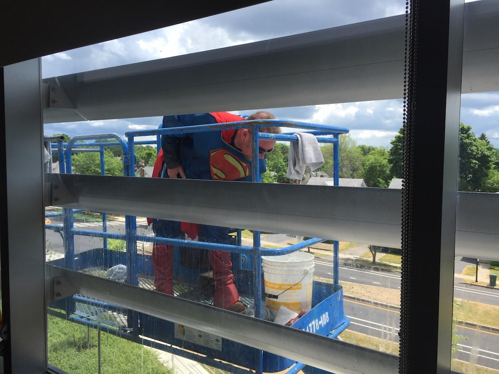 Who better to swing by a children's hospital window, but superman himself!